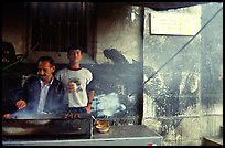 Food vendor broiling meat. Jerusalem, Israel ( color)