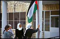 Women raise the Palestian flag at a school in East Jerusalem. Jerusalem, Israel