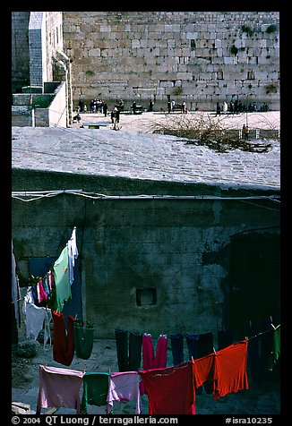 Laundry in a courtyard, with the Western Wall in the background. Jerusalem, Israel