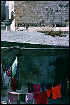 Laundry in a courtyard, with the Western Wall in the background. Jerusalem, Israel (color)