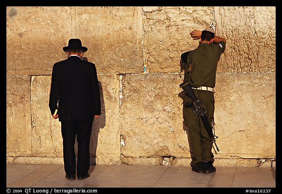 Orthodox Jew and soldier at the Western Wall. Jerusalem, Israel (color)