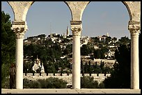 Spires and Mount of Olives seen through arches. Jerusalem, Israel