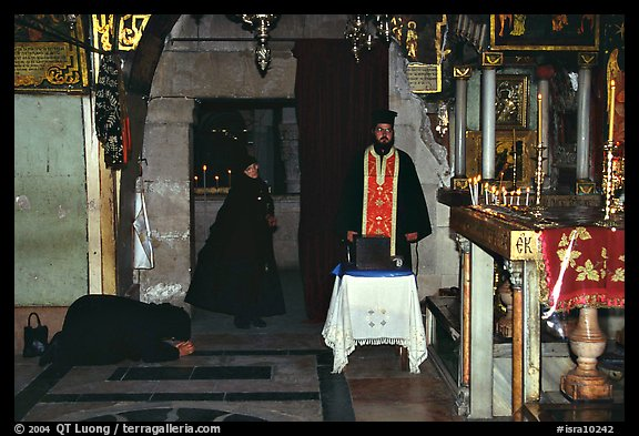 Worshiping inside the Church of the Holy Sepulchre. Jerusalem, Israel (color)