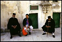 Copt monks and visitor in the Ethiopian Monastery. Jerusalem, Israel