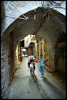Two children under an archway, Hebron. West Bank, Occupied Territories (Israel) ( color)