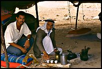 Bedouin men offering tea in a tent, Judean Desert. West Bank, Occupied Territories (Israel) ( color)