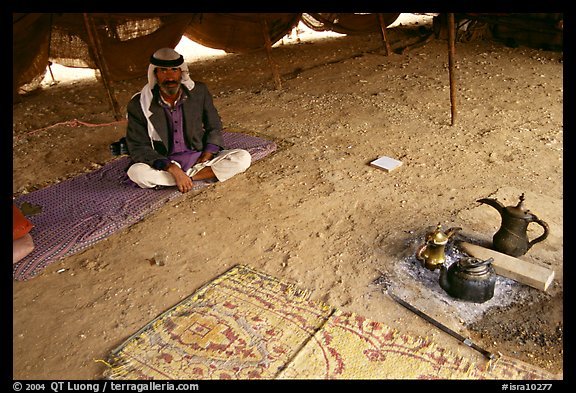 Bedouin man sitting on a carpet in a tent, Judean Desert. West Bank, Occupied Territories (Israel) (color)