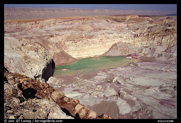 Shallow pond and colored rocks, near Mitzpe Ramon. Negev Desert, Israel (color)