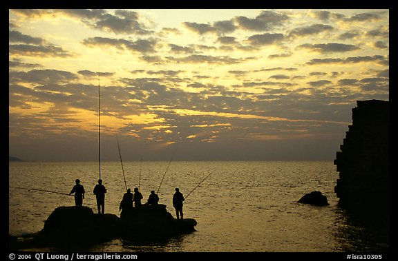 Fishermen standing on a rock, Akko (Acre). Israel