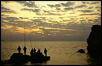 Fishermen standing on a rock, Akko (Acre). Israel ( color)