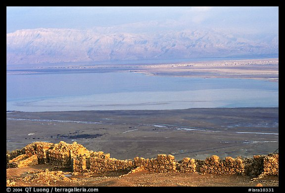 Ancient ruined walls of Masada and Dead Sea valley. Israel