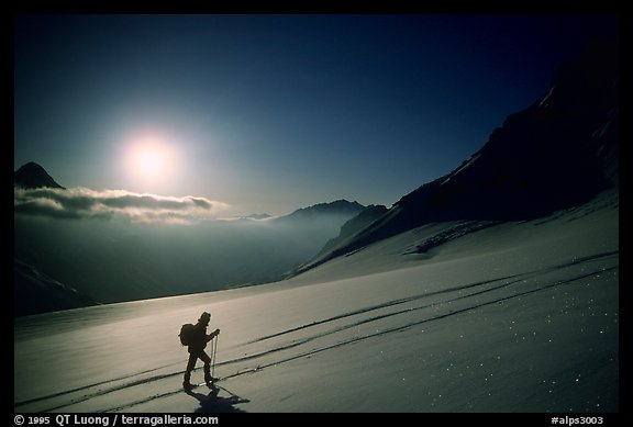 Backcountry skier climbs Dome de Chasseforet in the Vanoise Range, Alps, France.  (color)