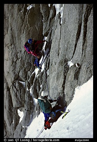 Climbers Frank and Alain start the Super-Couloir on Mt Blanc du Tacul, Mont-Blanc Range, Alps, France.  (color)