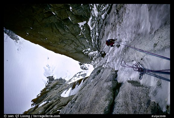 Climbers Frank and Alain climb thin ice in the Super-Couloir on Mt Blanc du Tacul, Mont-Blanc Range, Alps, France.  (color)