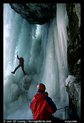 Paul and Vincent are going to avoid the vertical free standing section of the main falls of Gialorgues by climbing through an ice-tunnel, an experience of rare beauty. Alps, France (color)