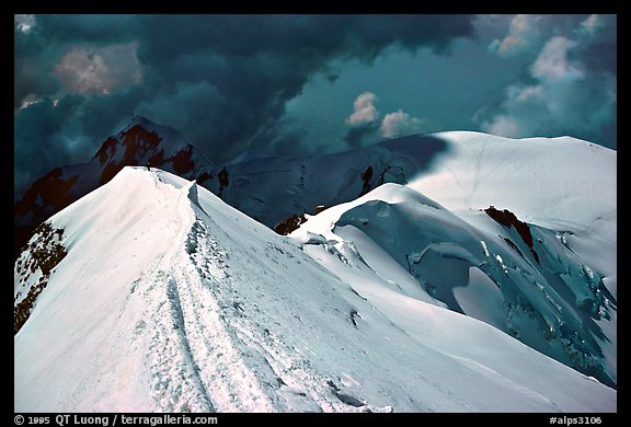 Summit ridge of Mont-Blanc and Bosses ridge with climber's trail in the snow, France and Italy.