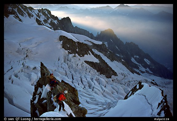 Climbers on the rocky part of the Brenva Spur, Mont-Blanc, Italy.  (color)