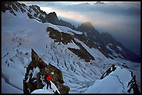 Climbers on the rocky part of the Brenva Spur, Mont-Blanc, Italy.