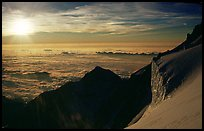 Sun setting over Bionnassay ridge, just under the summit of Mont-Blanc, Italy. (color)