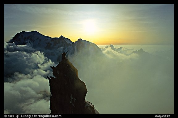 On the very narrow top of Dent du Geant, Mont-Blanc Range, Alps, France.  (color)