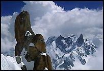 Alpinists on a pinacle of Aiguille du Midi after climbing the South Face. Alps, France