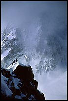 Alpinists on a buttress of Aiguille du Midi climbing the Cosmiques ridge. Alps, France