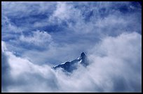 Aiguille du Midi summit emerges from the clouds. Alps, France