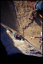 Climbing  the Triple Cracks, the crux of the route. El Capitan, Yosemite, California (color)