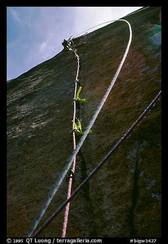 Leading the next pitch, a thin crack in the middle of nowhere. El Capitan, Yosemite, California (color)