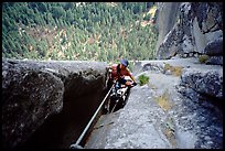 We suffer hauling through a chimney. Washington Column, Yosemite, California (color)