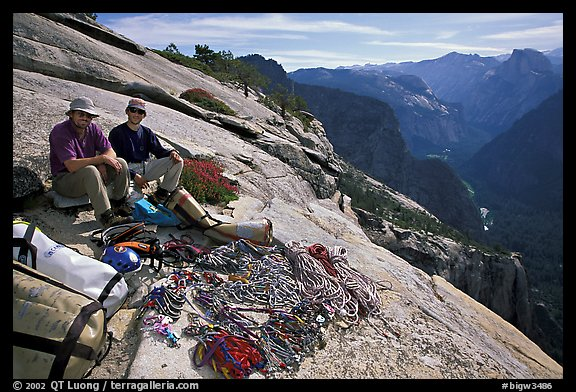Valerio Folco and Tom McMillan with gear at the top of the wall. El Capitan, Yosemite, California (color)