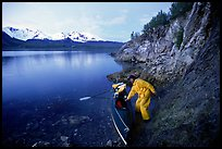 Kayaker pulling on shore at midnight, Muir Inlet. Glacier Bay National Park, Alaska (color)