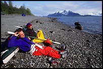 Kayakers relaxing on a beach between Rendu Inlet and Russel Island. Glacier Bay National Park, Alaska