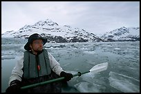 Kayaker on ice-chocked waters close to John Hopkins Inlet. Glacier Bay National Park, Alaska (color)