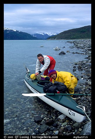 Kayaker packing tight into a double kayak. Glacier Bay National Park, Alaska (color)