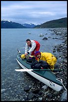 Kayaker packing tight into a double kayak. Glacier Bay National Park, Alaska