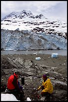 Cooking in front of Lamplugh Glacier. Glacier Bay National Park, Alaska (color)