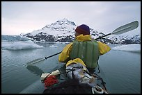 Kayaker paddling amongst icebergs near John Hopkins Inlet. Glacier Bay National Park, Alaska