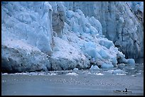 Kayaker bellow  the front of Lamplugh Glacier. Glacier Bay National Park, Alaska (color)