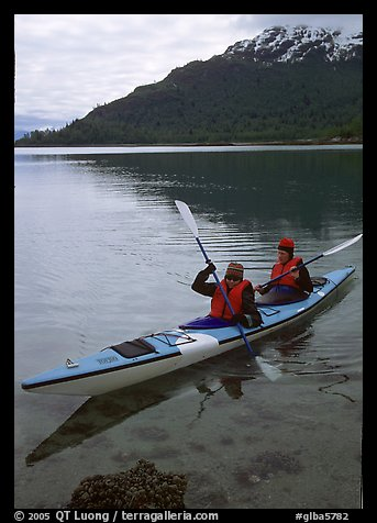 Kayakers in Hugh Miller Inlet. Glacier Bay National Park, Alaska (color)