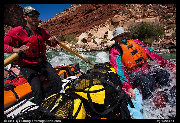 Boatman and passenger splashed in rapid. Grand Canyon National Park, Arizona (color)