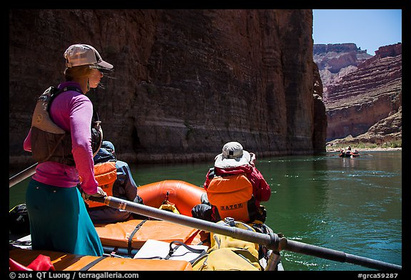 On raft passing below redwall limestone cliff. Grand Canyon National Park, Arizona (color)