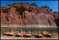 Rafts moored opposite redwall limestone cliff. Grand Canyon National Park, Arizona ( color)