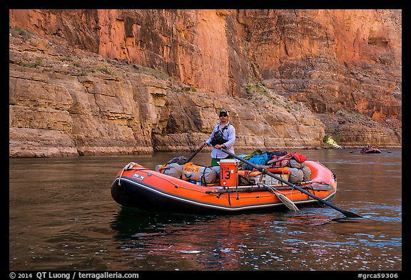 Paddling calm stretch of Colorado River between towering walls. Grand Canyon National Park, Arizona (color)