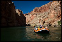 Paddling calm stretch of Colorado River beneath towering walls. Grand Canyon National Park, Arizona ( color)