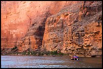 Oar raft below sheet Redwall limestone canyon walls. Grand Canyon National Park, Arizona ( color)
