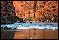Glassy river, rapids and boat below Redwall canyon walls. Grand Canyon National Park, Arizona ( color)