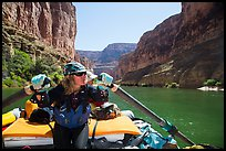 Woman rows raft on calm section of Colorado River, Marble Canyon. Grand Canyon National Park, Arizona ( color)