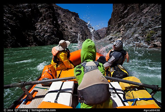 Oar-powered raft hits wave in rapids. Grand Canyon National Park, Arizona (color)