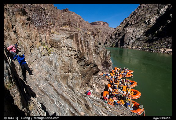 Scrambling on rocks towards rafts at the month of Clear Creek canyon. Grand Canyon National Park, Arizona (color)